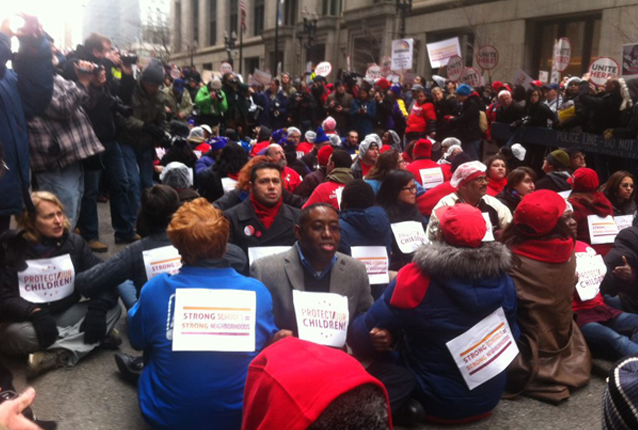Front row facing forward: Elce Redmond, Chicago Jobs with Justice Co-Chair and Jobs with Justice National Board member, risking arrest in support of Chicago teachers strike
