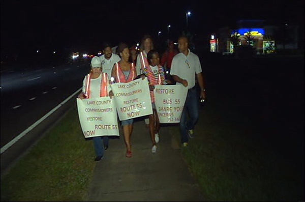 Lake County public transit riders stage march along canceled bus route