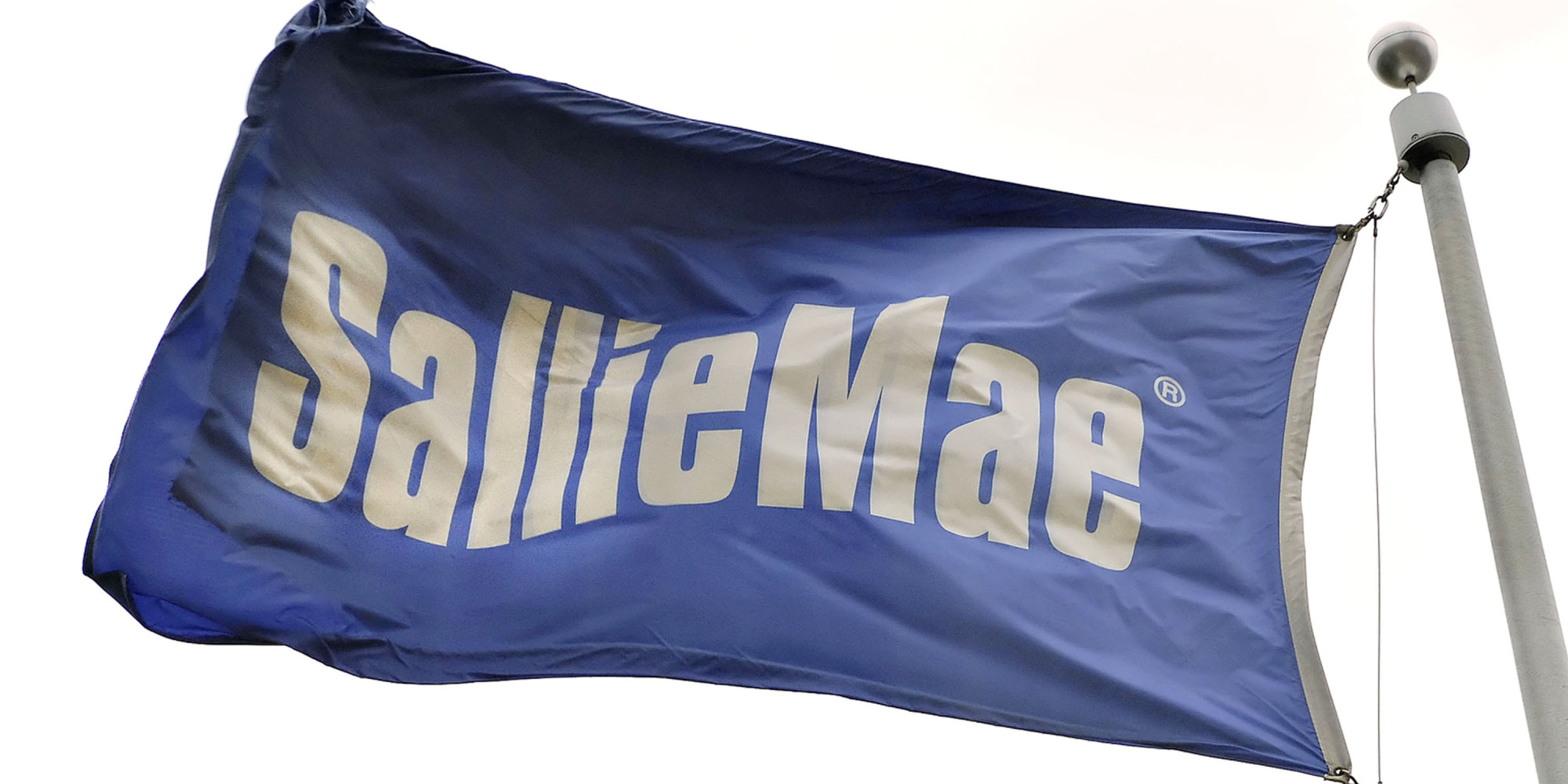A flag flies outside a Sallie Mae building in Reston, Virgin