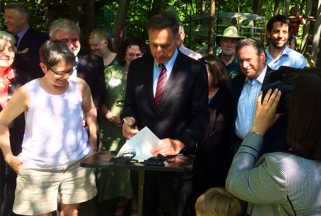 Vermont Governor Peter Shumlin signs into law a bill that guarantees early childhood educators the right to organize and collectively bargain with the state. Photo via Photo via Facebook page Vermont Early Educators United AFT