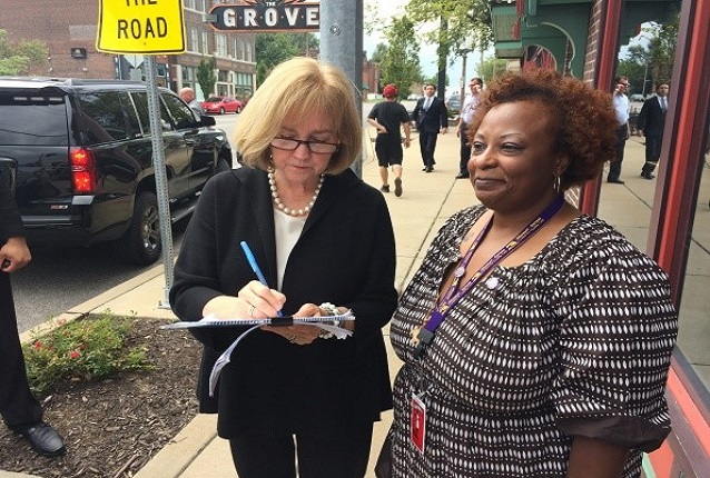 Arnessa Johnson collects the signature of St. Louis Mayor Lyda Krewson to place the Raise Up Missouri minimum wage initiative on the ballot this fall.